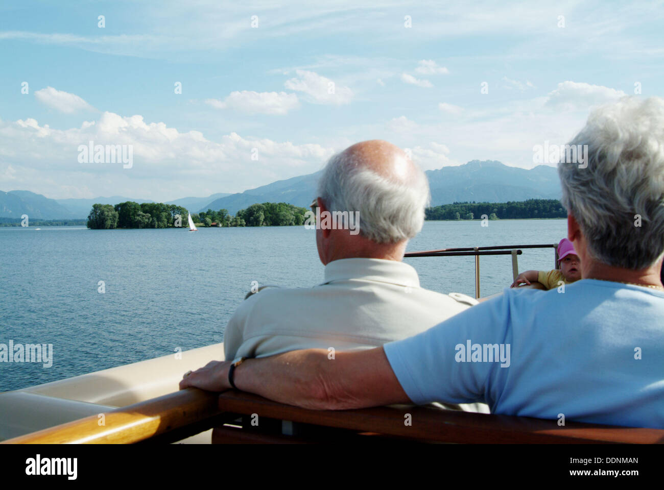 People on a ferry (Weisse Flotte) on Chiemsee. At the background: island Herreninsel (on Herreninsel you´ll find the castle - Stock Image