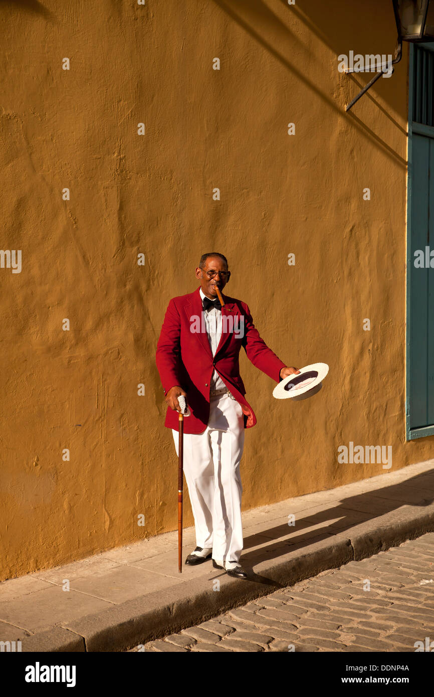 the actor Pedro Pablo Perez with red suit, hat and cigar in Havana, Cuba, Caribbean - Stock Image