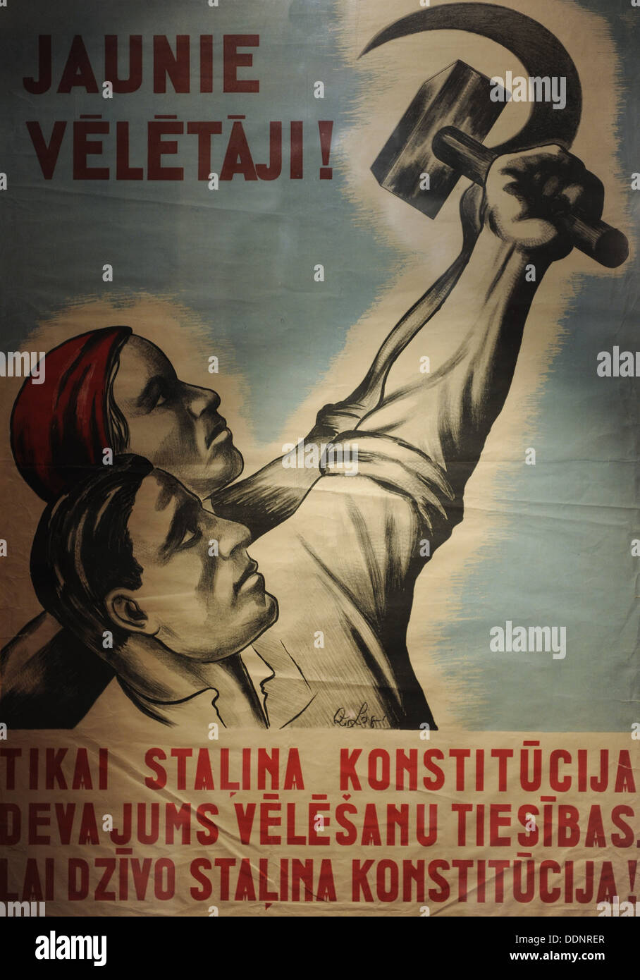 Poster:' New voters!. Long live Stalin's Constitution!'. Second Soviet Occupation 1944-1991. Occupation Museum of Latvia. Riga. - Stock Image