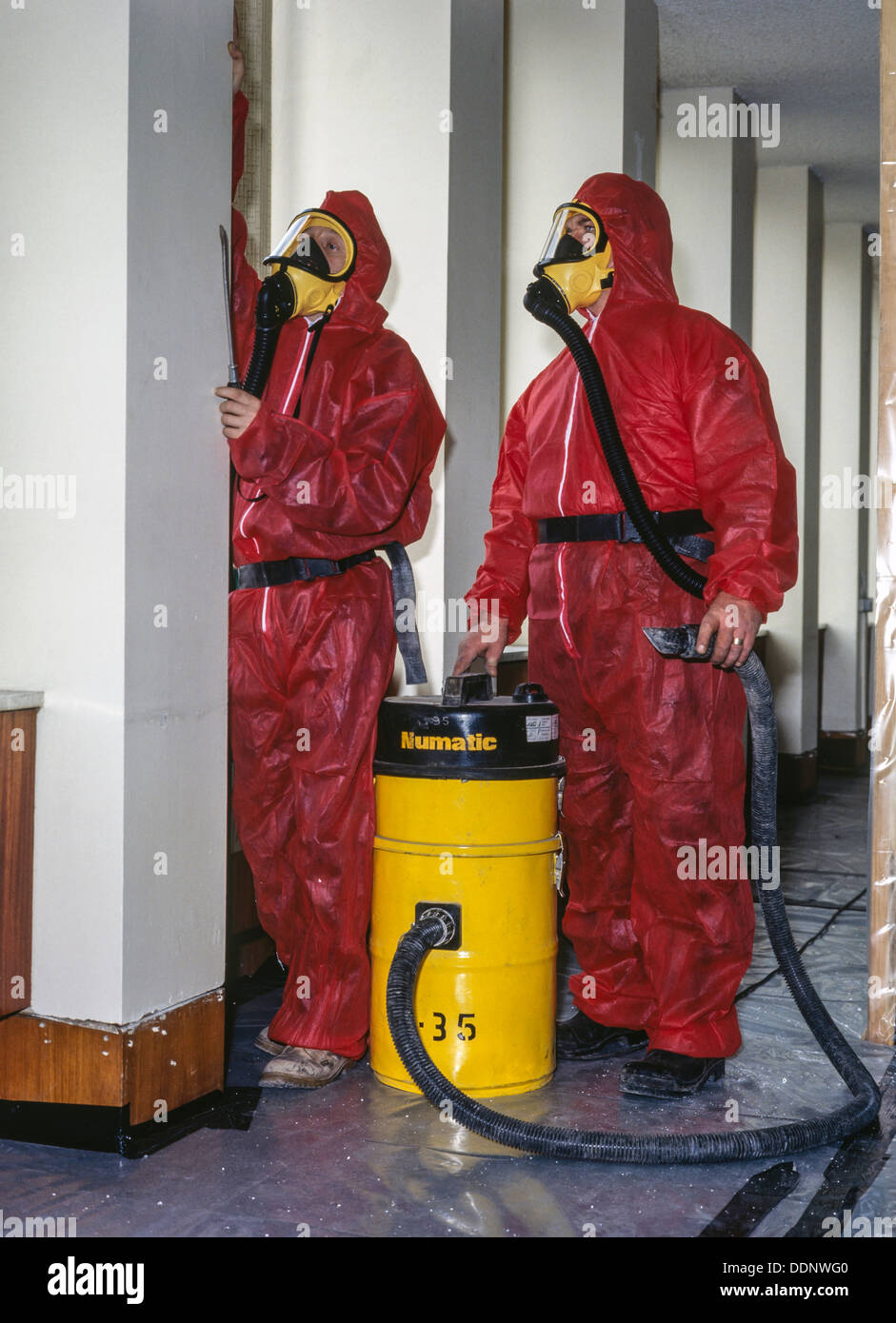 Asbestos removal workers, UK - Stock Image