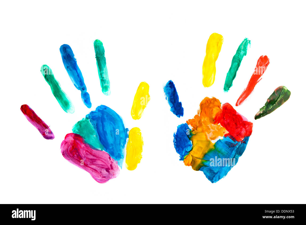 Colourful hand prints painted, stamped on paper - Stock Image