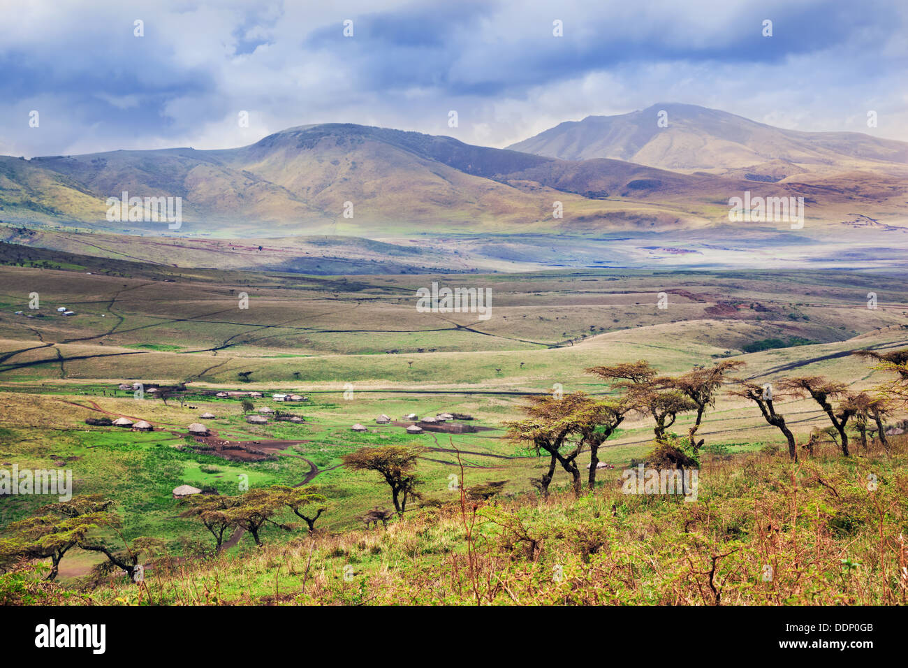 Landscape, Africa -  Savannah landscape in Tanzania, Africa. Maasai houses in the valley - Stock Image