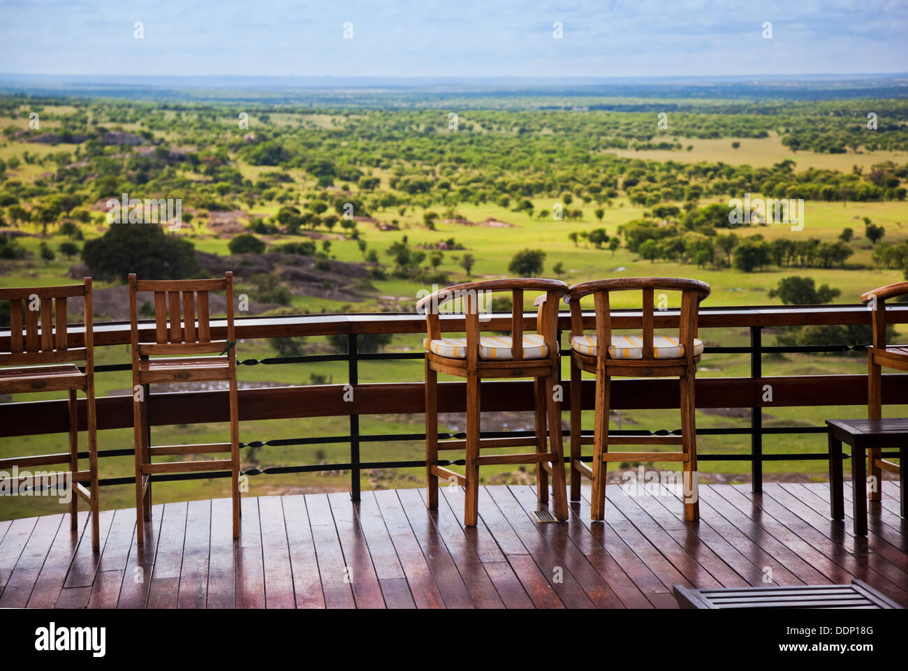 Serengeti, Tanzania, Africa. Chairs on the terrace of a lodge overlooking the plains - Stock Image