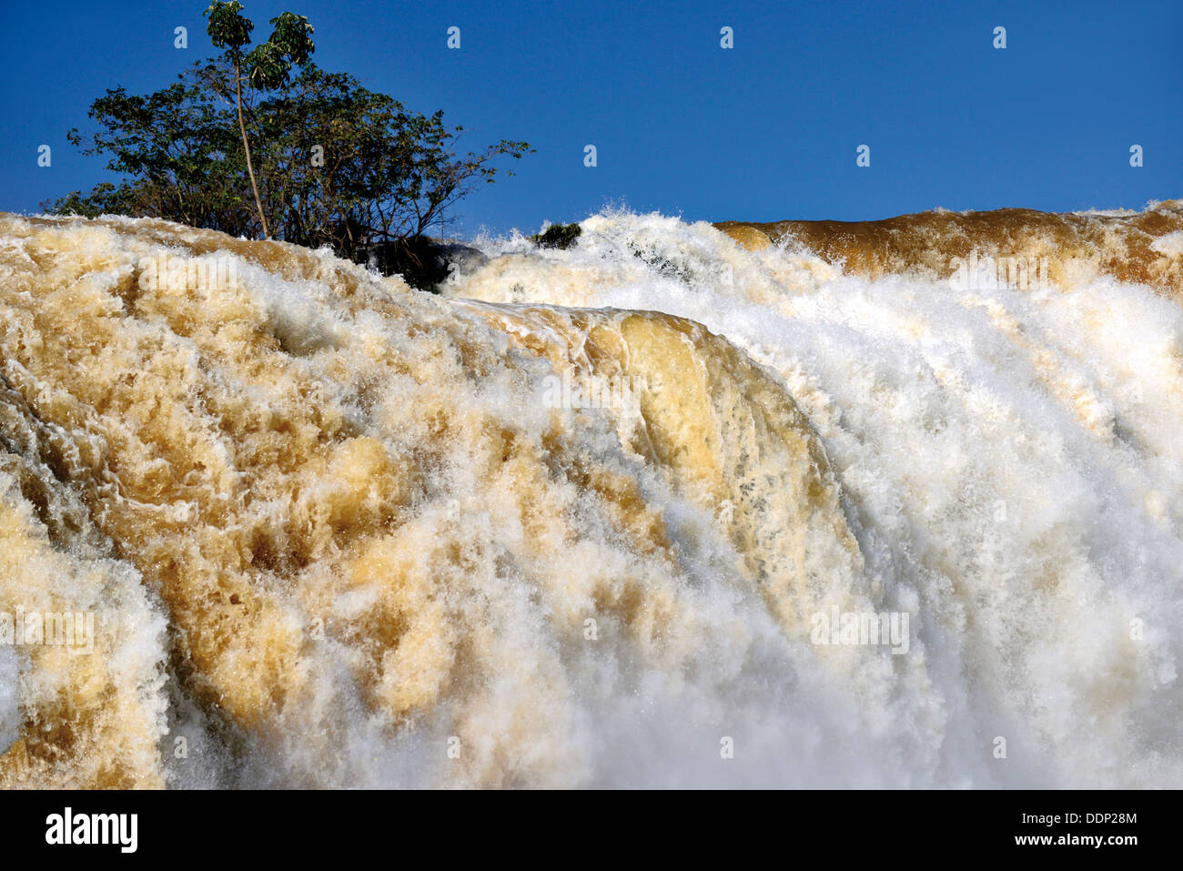 Brazil, Paraná: Iguassu Falls  with record water levels after heavy rainfall - Stock Image