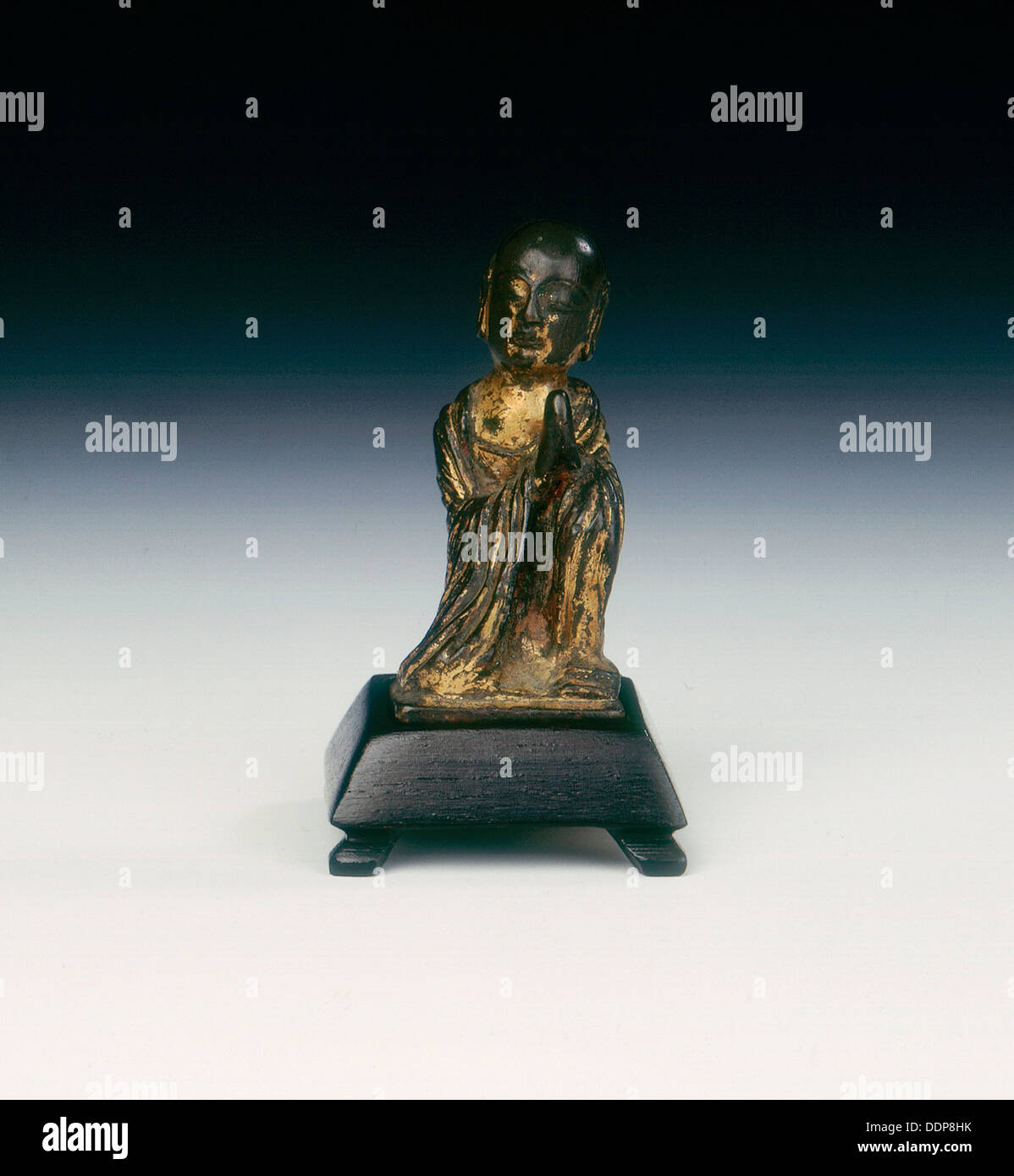 Gilt bronze figure of a monk, Late Six Dynasties period or Tang dynasty, China, 6th-10th century. - Stock Image