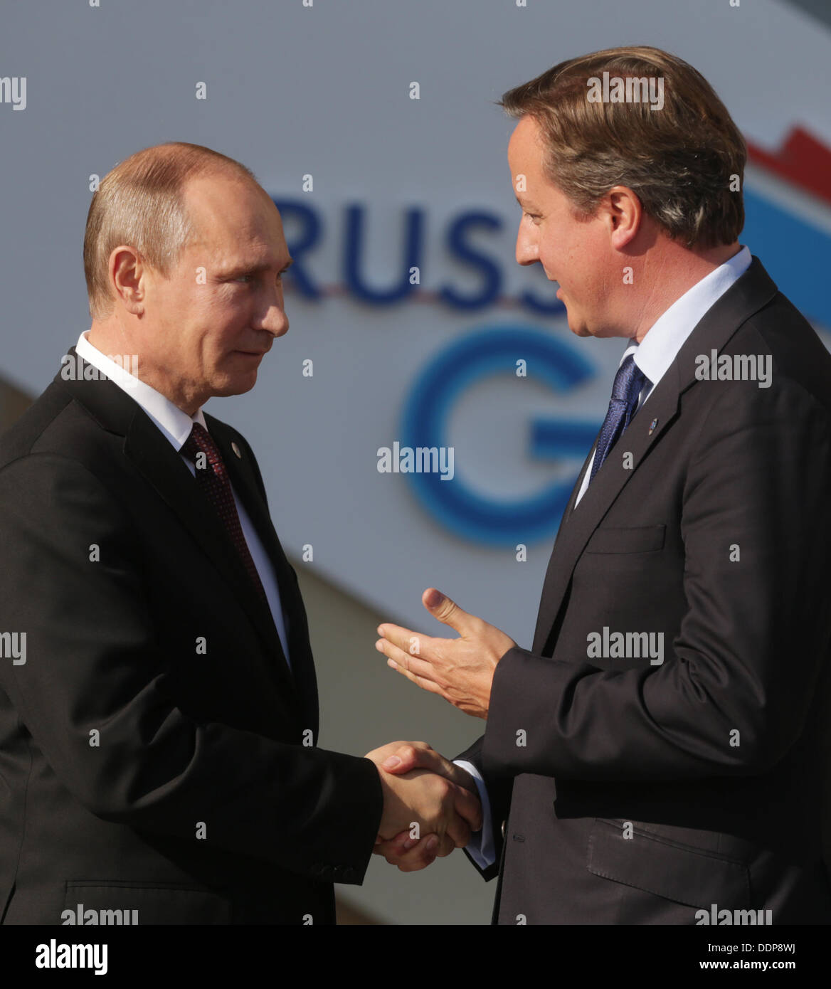 St. Petersburg, Russia. 05th Sep, 2013. Russian President Vladimir Putin (L) welcomes Britain's Prime Minister David Stock Photo