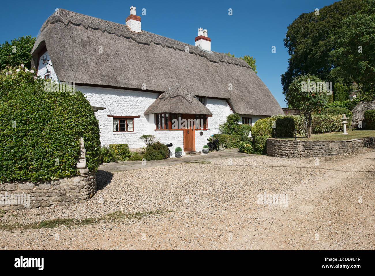 A beautiful traditional English country cottage with thatched roof in Stanton Fitzwarren, Wiltshire, England, UK - Stock Image