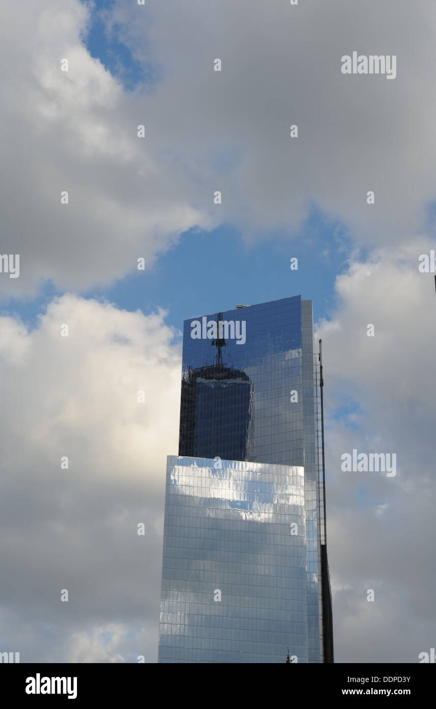 1 World Trade Center is reflected in the facade of 4 World Trade Center in lower Manhattan. - Stock Image