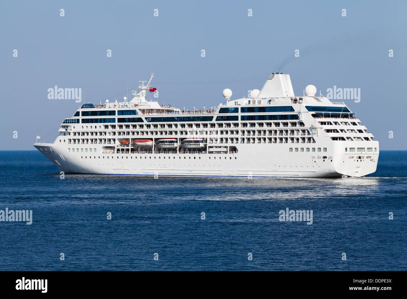 passenger ship afloat side leaving - Stock Image