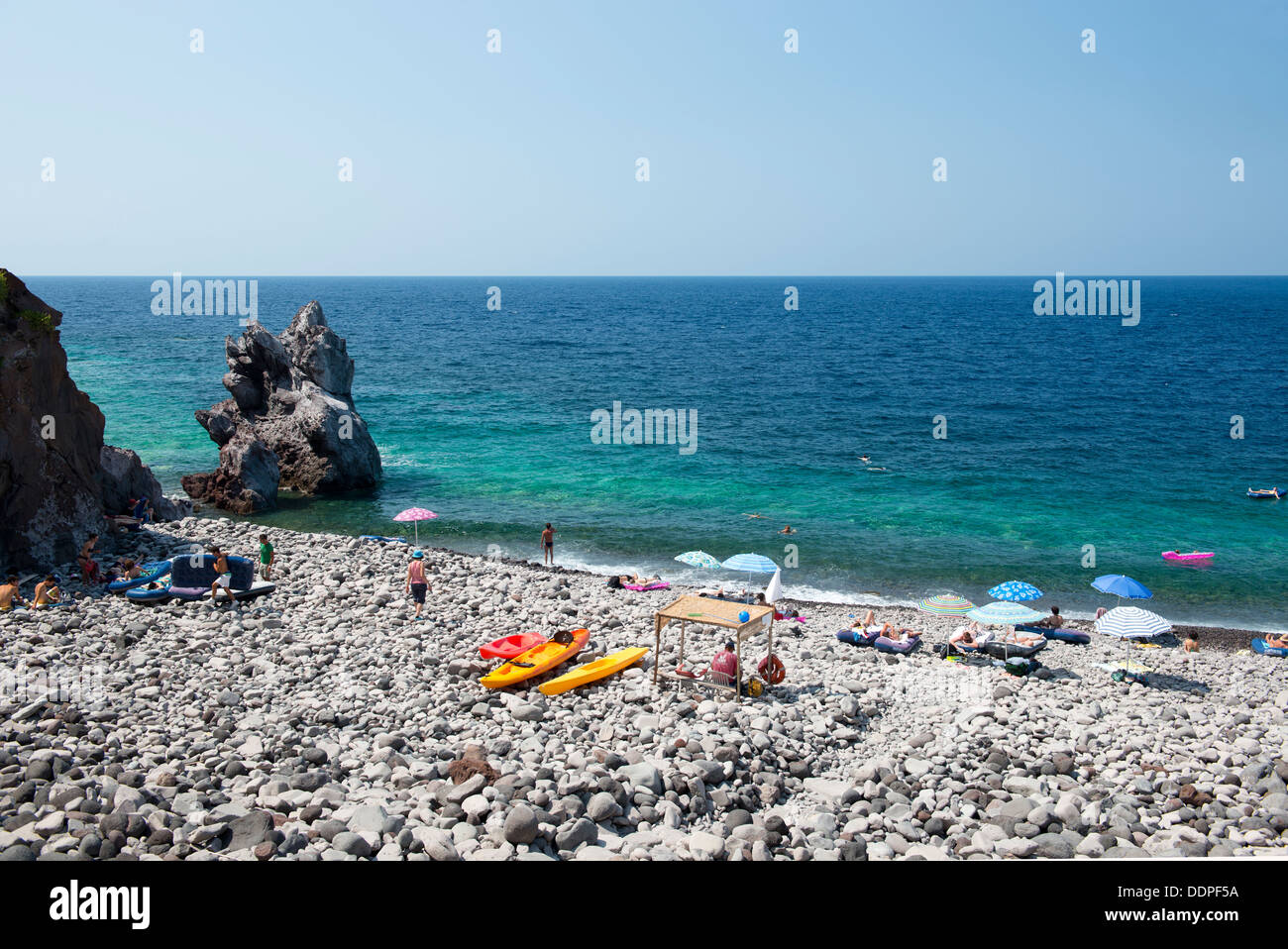 The rocky beach at Malfa, Salina, The Aeolian Islands, Messina, Sicily, Italy - Stock Image
