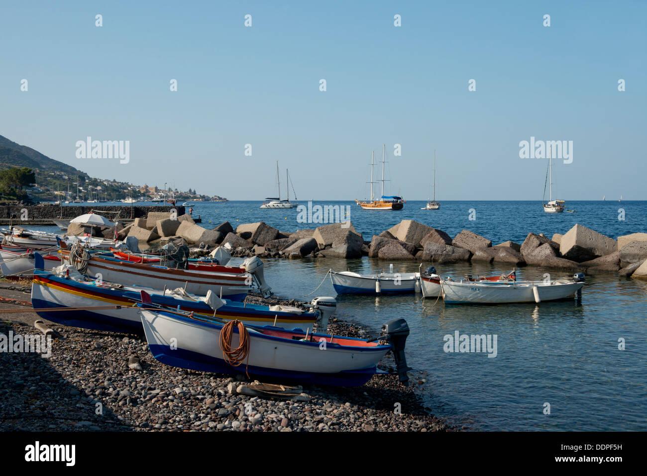 Fishing boats and sail boats near Lingua, Salina, The Aeolian Islands, Messina, Sicily, Italy - Stock Image