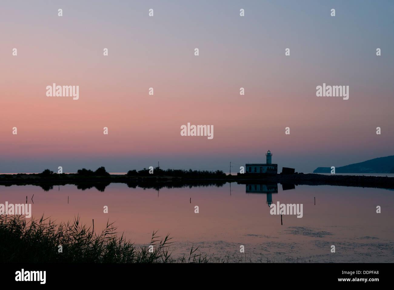 The Punta Lingua Lighthouse at sunrise on the island of Salina in the Aeolian Islands, Sicily, Italy - Stock Image