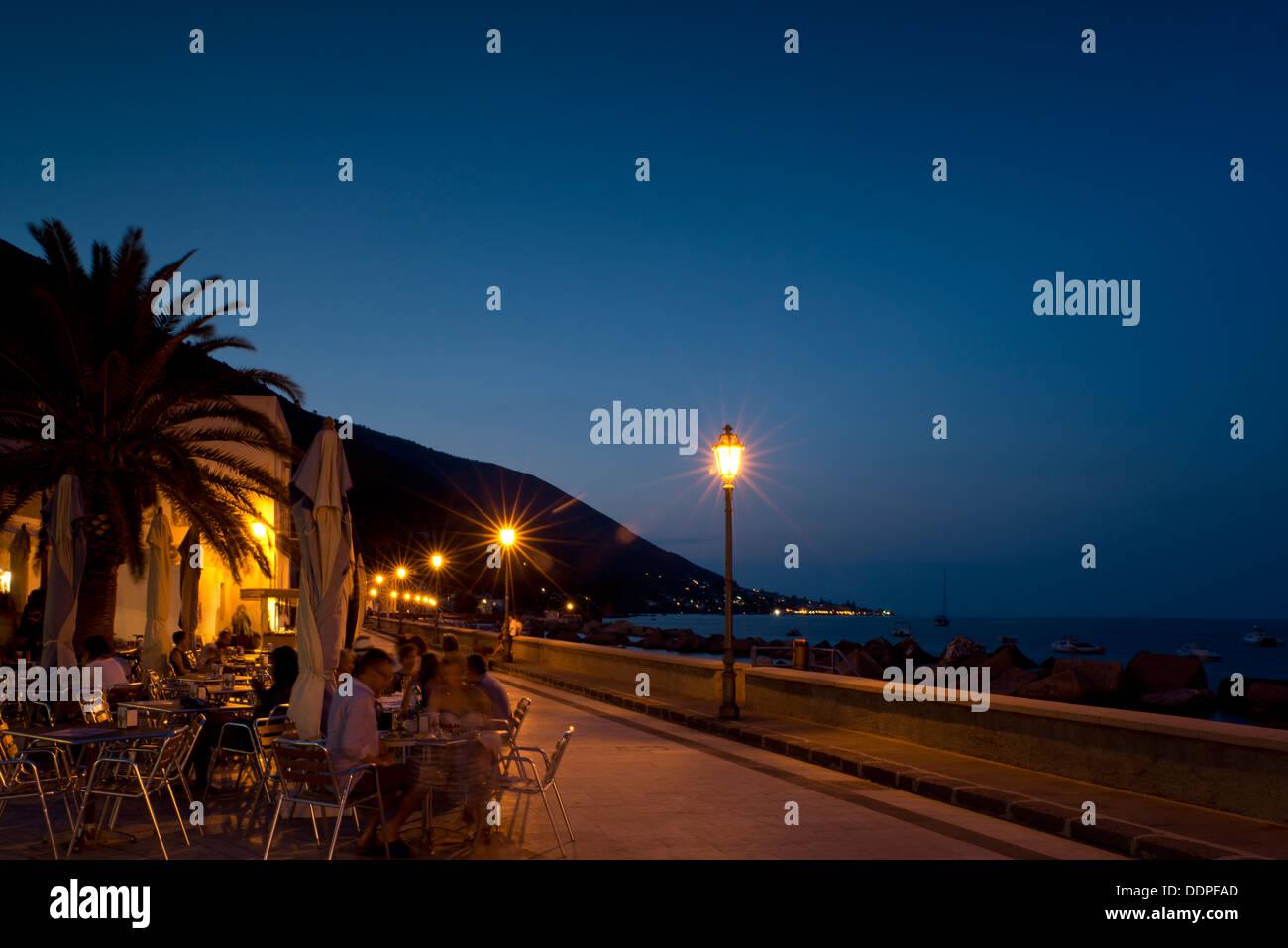 Restaurants at dusk along the seafront in Lingua, Salina, The Aeolian Islands, Sicily, Italy - Stock Image