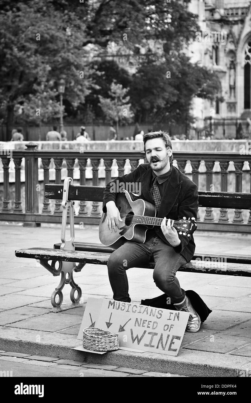 musician busking in paris city centre - Stock Image
