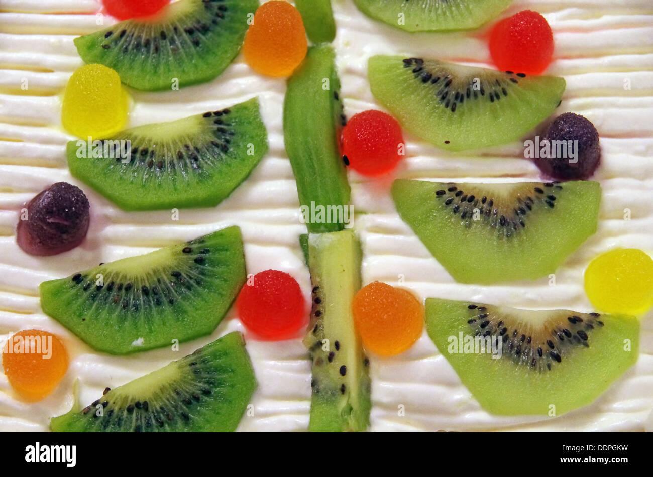 Cake with kiwi fruit, as a background - Stock Image