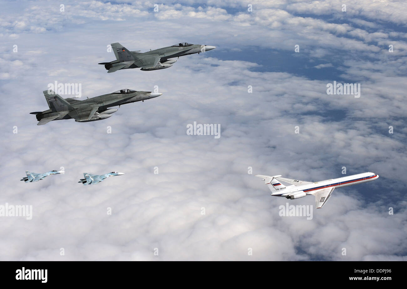 Canadian CF18 Hornet aircraft from 409 Squadron in Cold Lake, Alberta and Russian Su-27 aircraft from Anadyr, Russia Stock Photo