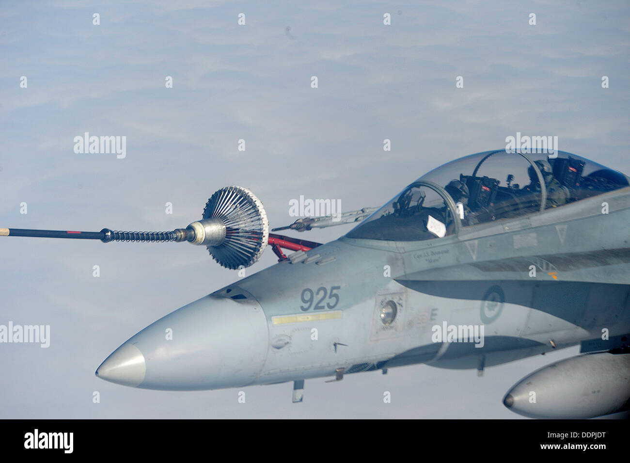 A Royal Canadian Air Force CF-18 Hornet receives fuel from a CC-150T Polaris Aug. 28, 2013 during Exercise Vigilant Stock Photo