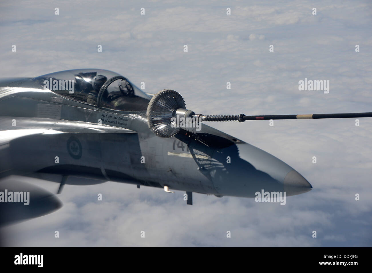 A Royal Canadian Air Force CF-18 Hornet receives fuel from a CC-150T Polaris Aug. 28, 2013 at Exercise Vigilant Stock Photo