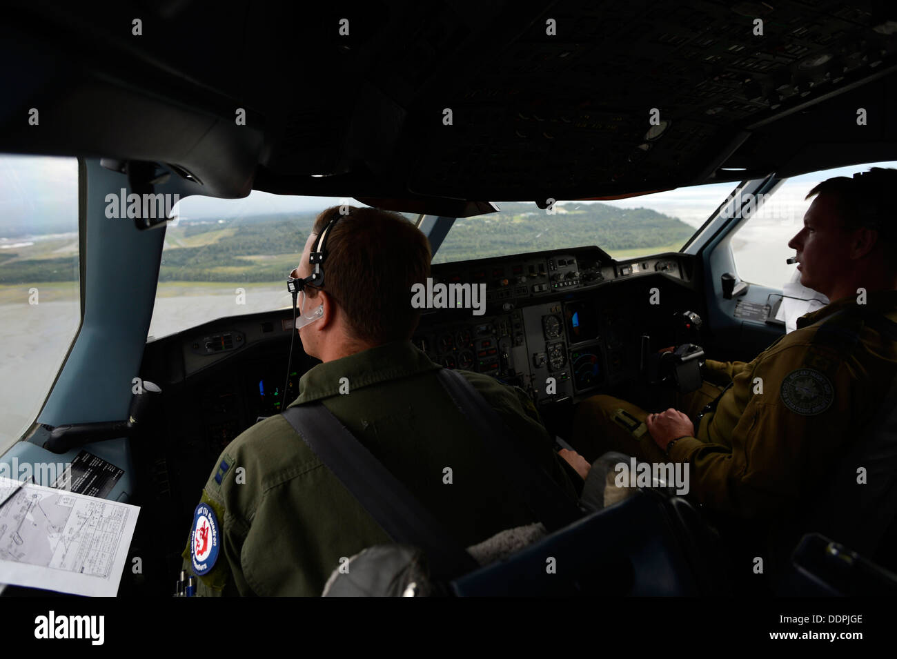 U.S. Air Force Capt. Joe Caruso and Royal Canadian Air Force Capt. Marc Andre Asselin pilot a CC-150T Polaris in Stock Photo