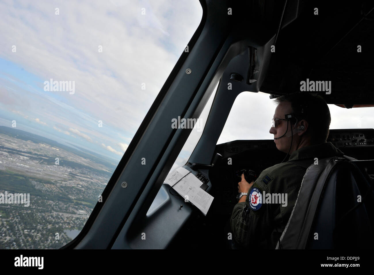 U.S. Air Force Capt. Joe Caruso an exchange pilot with the Royal Canadian Air Force pilots a CC-150T Polaris on Stock Photo