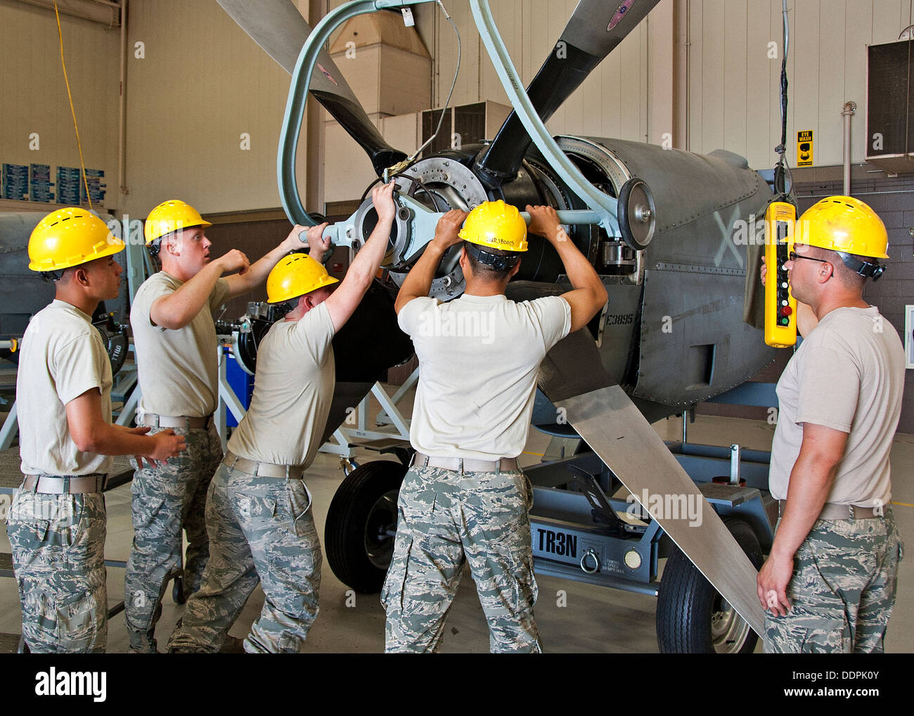 U.S. Air Force Airman Christian Botello, Justin Trathen, Instructor Staff Sgt. Justin Boyd, Airman Samuel Kwon and Airman 1st Class Kyle Koepkey, 361st Training Squadron, Jet Propulsion course are installing a Propeller Lifting Adapter for the removal of - Stock Image
