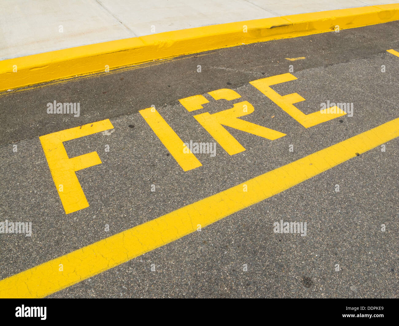 Painted Curbside Fire Lane Sign, USA - Stock Image