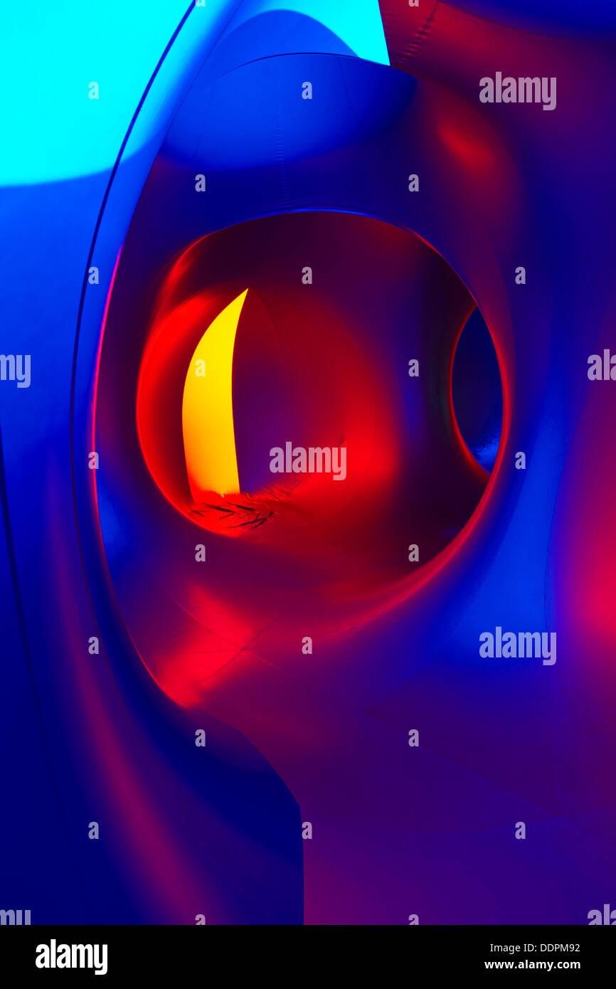 Inside the Amococo Luminarium at Bournemouth, Dorset UK  in September  - colourful abstract multi-coloured multi Stock Photo