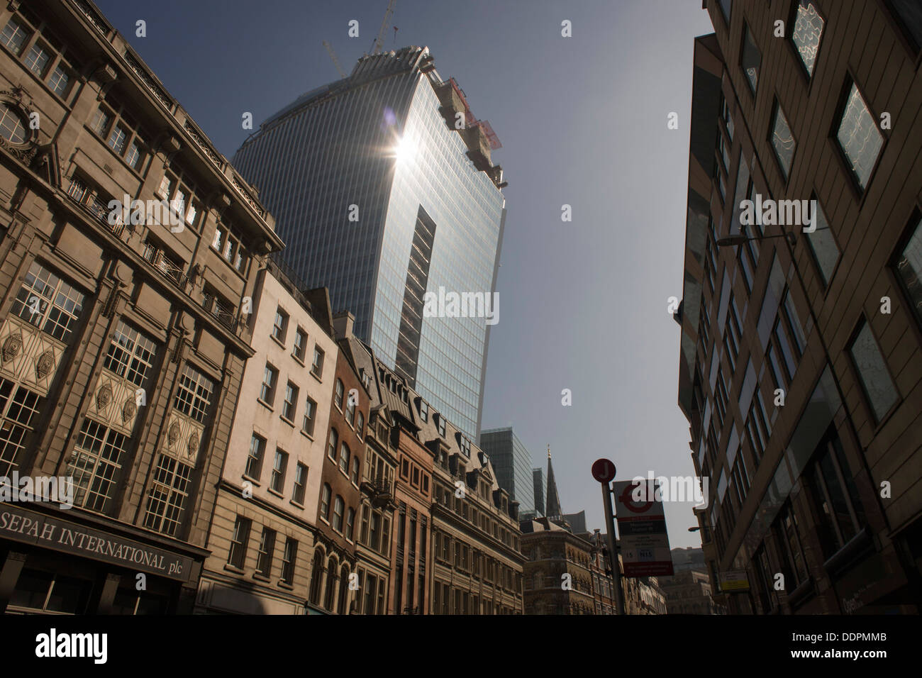 The intensive glare of solar rays reflected off the concave plate glass windows of one of the capital's newest skyscrapers known as the Walkie Talkie. The hotspot has surprised developers and passers-by below and which has already melted a parked car in Eastcheap Street. Thermometers placed in the street reached 144F (62 Celsius) and city workers poured out of their offices at lunchtime to experience the intense light and heat. - Stock Image