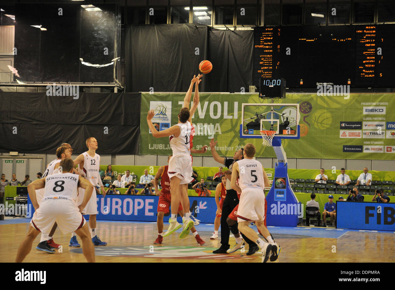 Jump for first ball possession. Beginning of the game. - Stock Image
