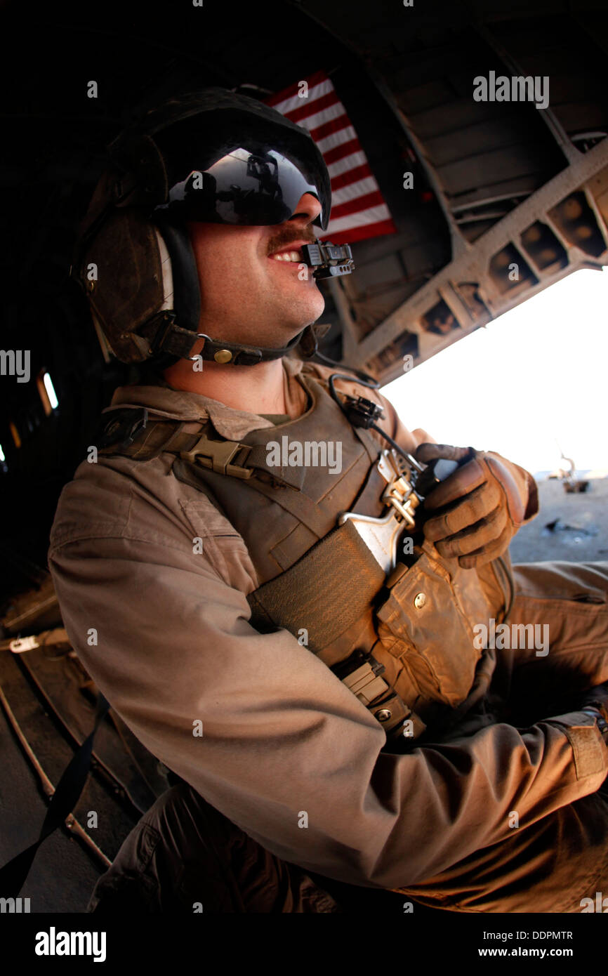 U.S. Marine Corps Cpl. Ryan P. Wells, a crew chief with Marine Heavy Helicopter Squadron 462 (HMH-462), provides Stock Photo