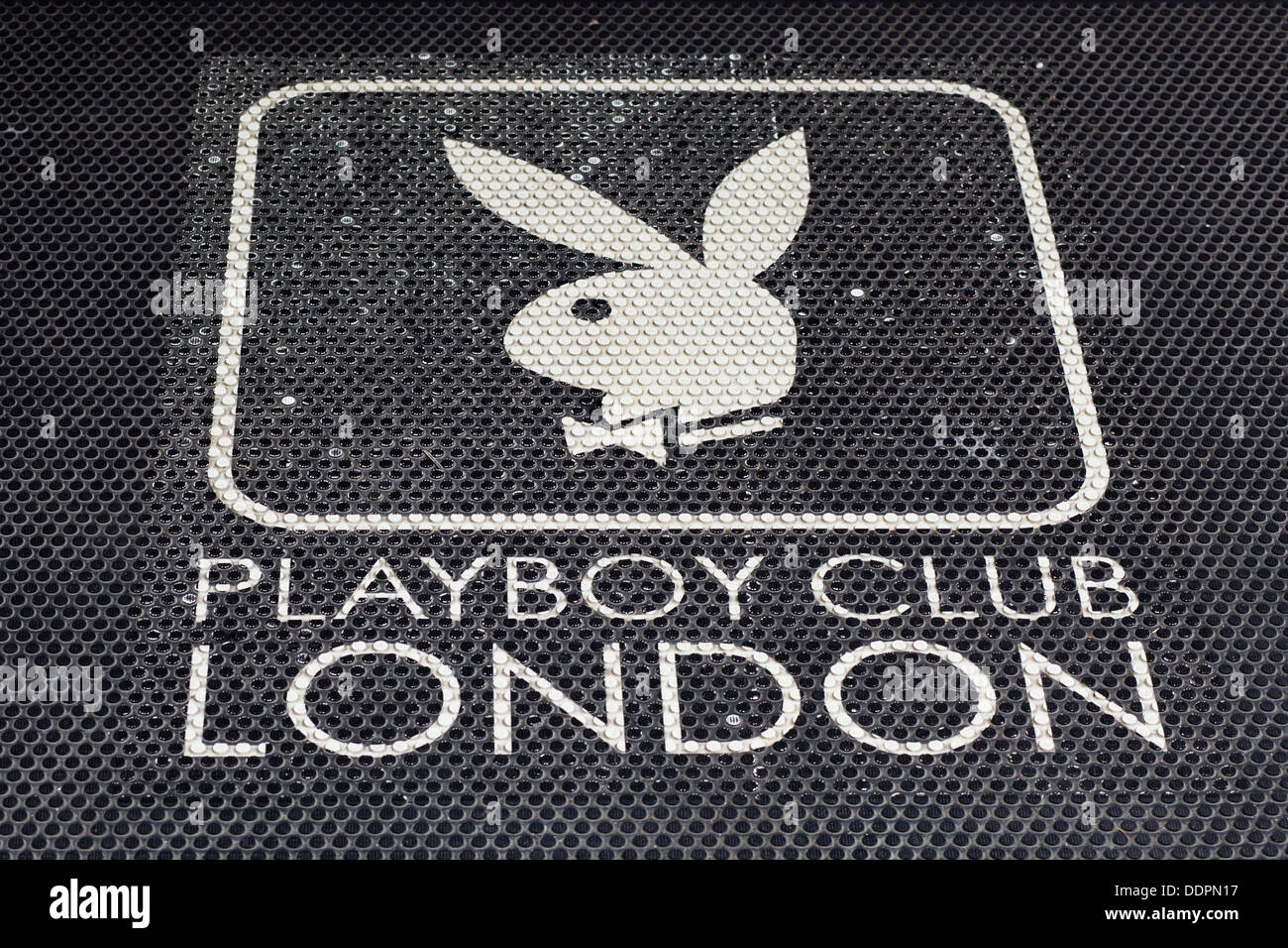 Doormat at the Entrance to the Playboy Club London - Stock Image
