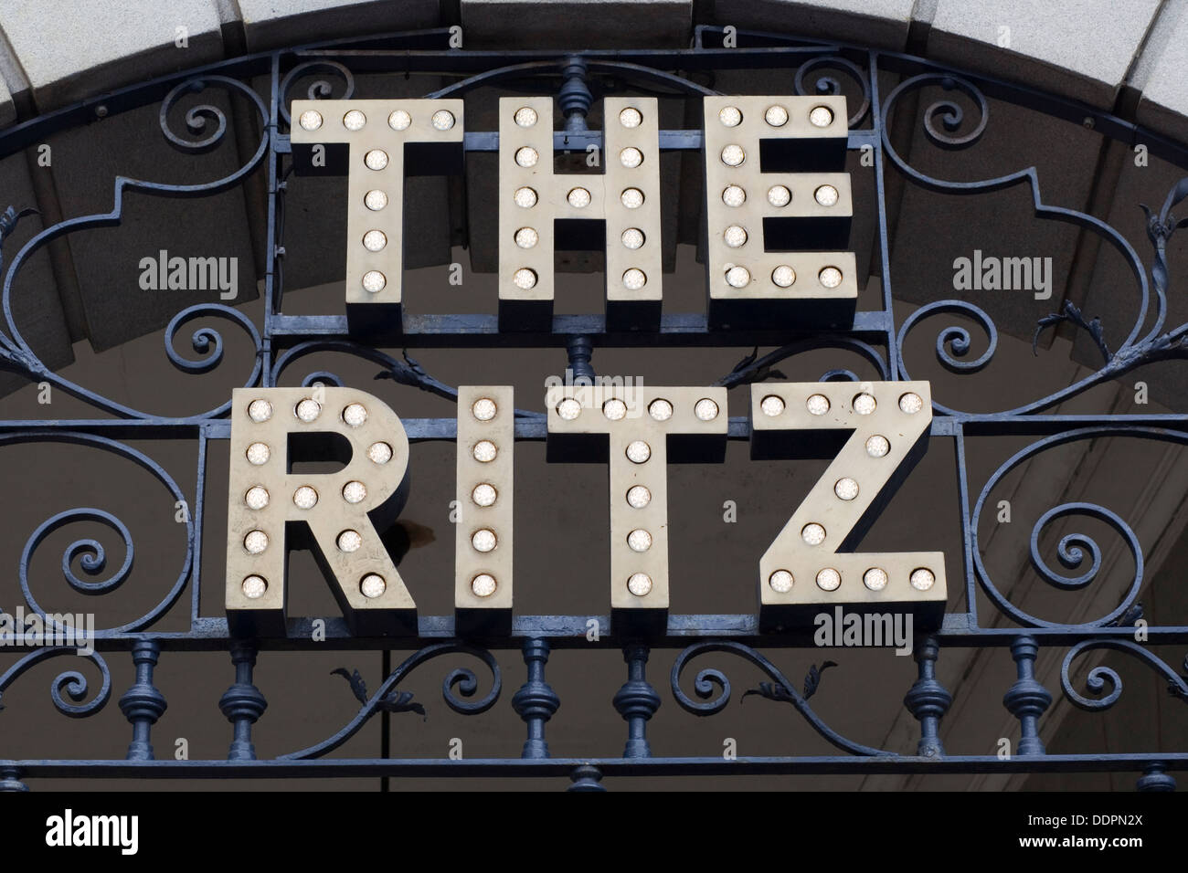 Sign for the Ritz Hotel above the western entrance to the arcade London England - Stock Image