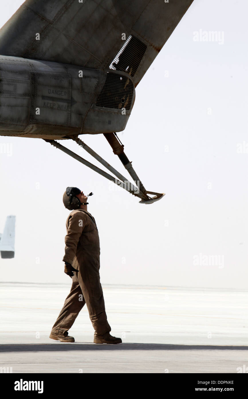 U.S. Marine Corps Cpl. Ryan P. Wells, a crew chief with Marine Heavy Helicopter Squadron 462 (HMH-462), inspects Stock Photo
