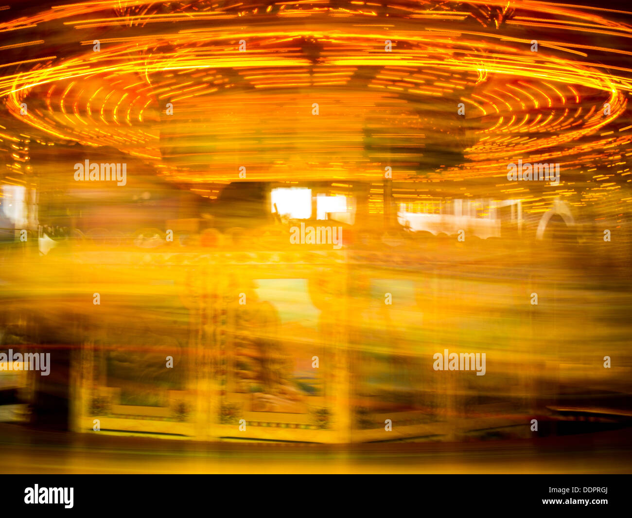 An abstract image of an illuminated carousel at speed Stock Photo