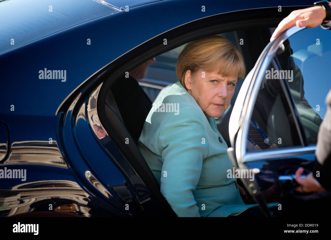 St. Petersburg, Russia. 06th Sep, 2013. German Chancellor Angela Merkel gets out of her limousine at the G20 summit. Stock Photo