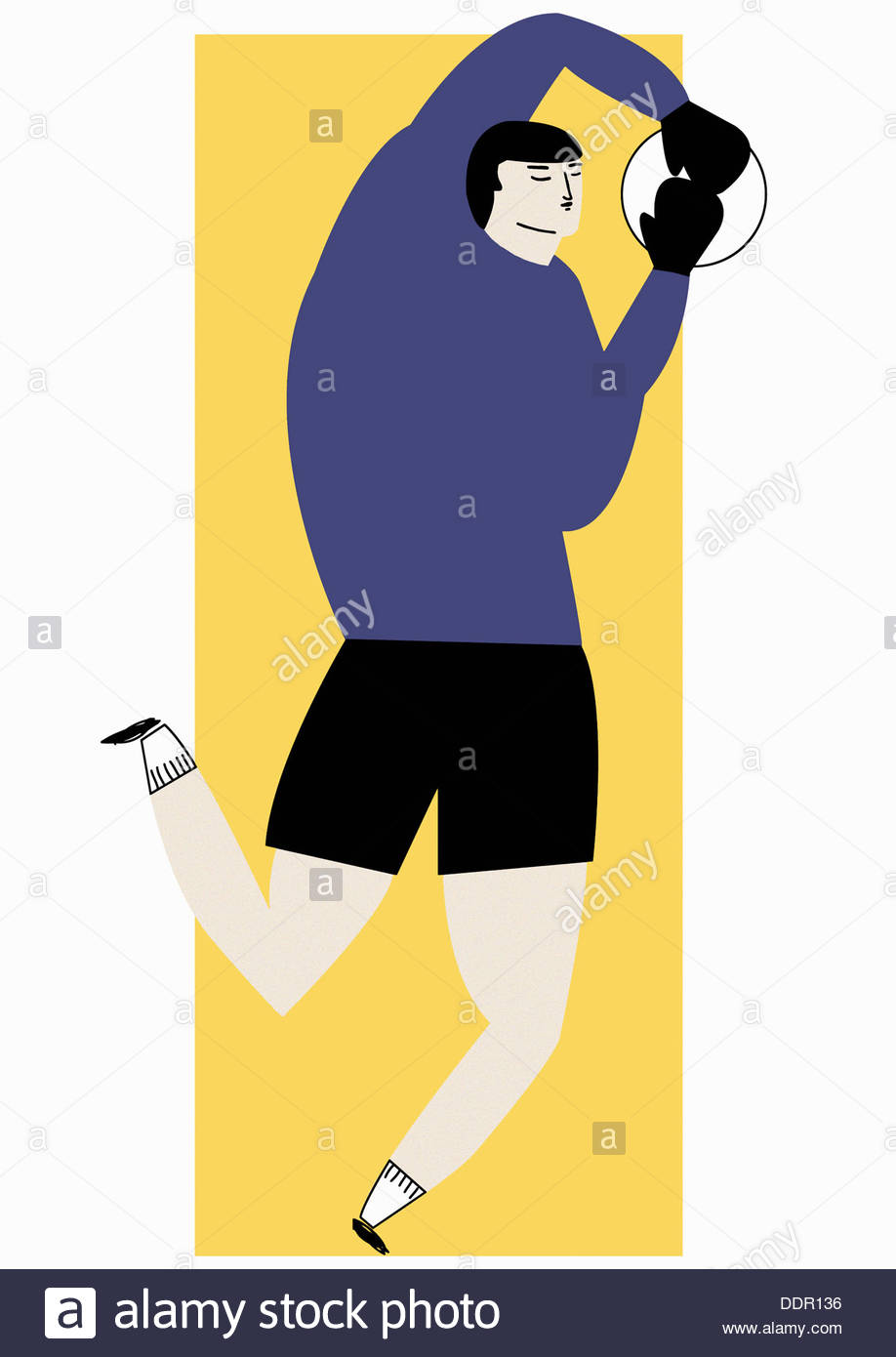 Soccer goalkeeper catching football - Stock Image