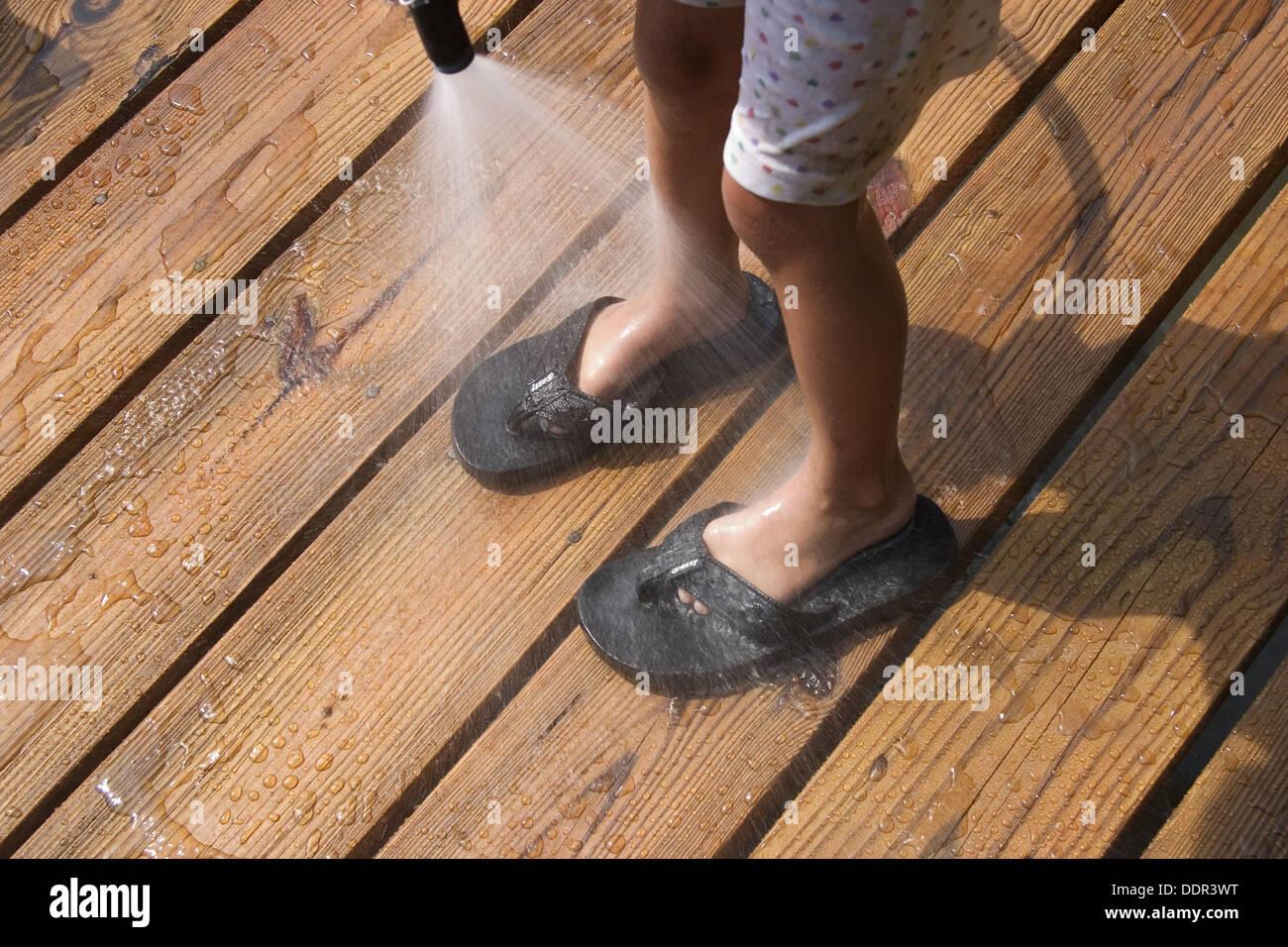 6e561f0bb065e Young Girl Wearing Flip Flops Stock Photos   Young Girl Wearing Flip ...