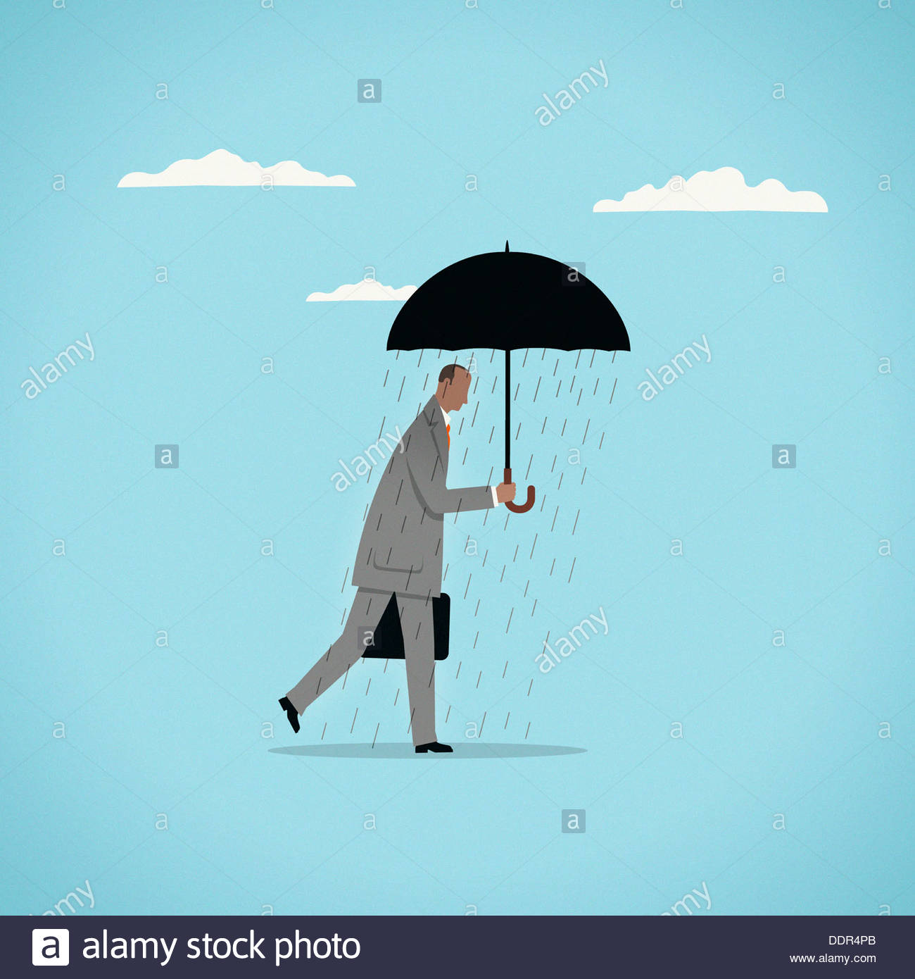 Rain falling from under umbrella on businessman - Stock Image