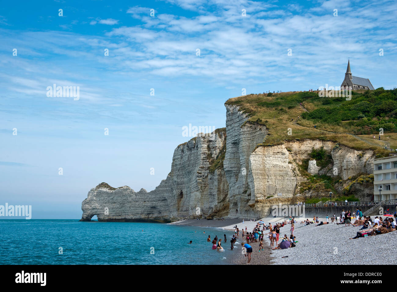 The beach and the cliff of Etretat in summer - Haute-Normandie, France - Stock Image