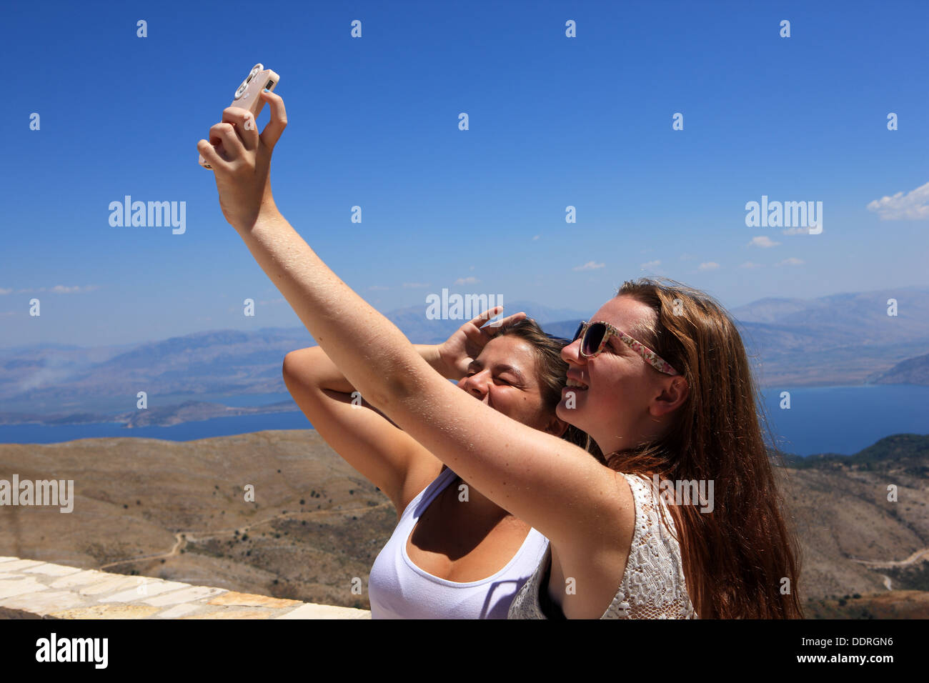 Girls on holiday taking a selfie, self-portrait photograph, the word made the Oxford Dictionaries online update in August 2013 - Stock Image