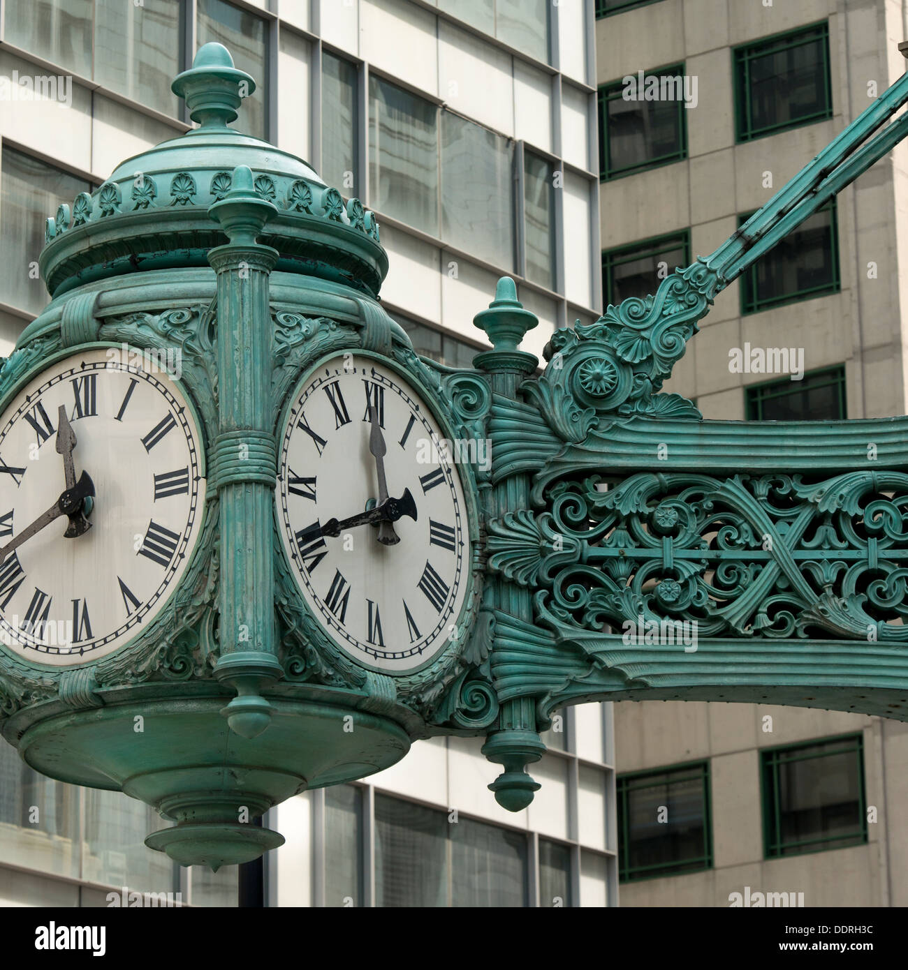 Low angle view of a clock on Marshall Field And Company, Chicago, Cook County, Illinois, USA - Stock Image