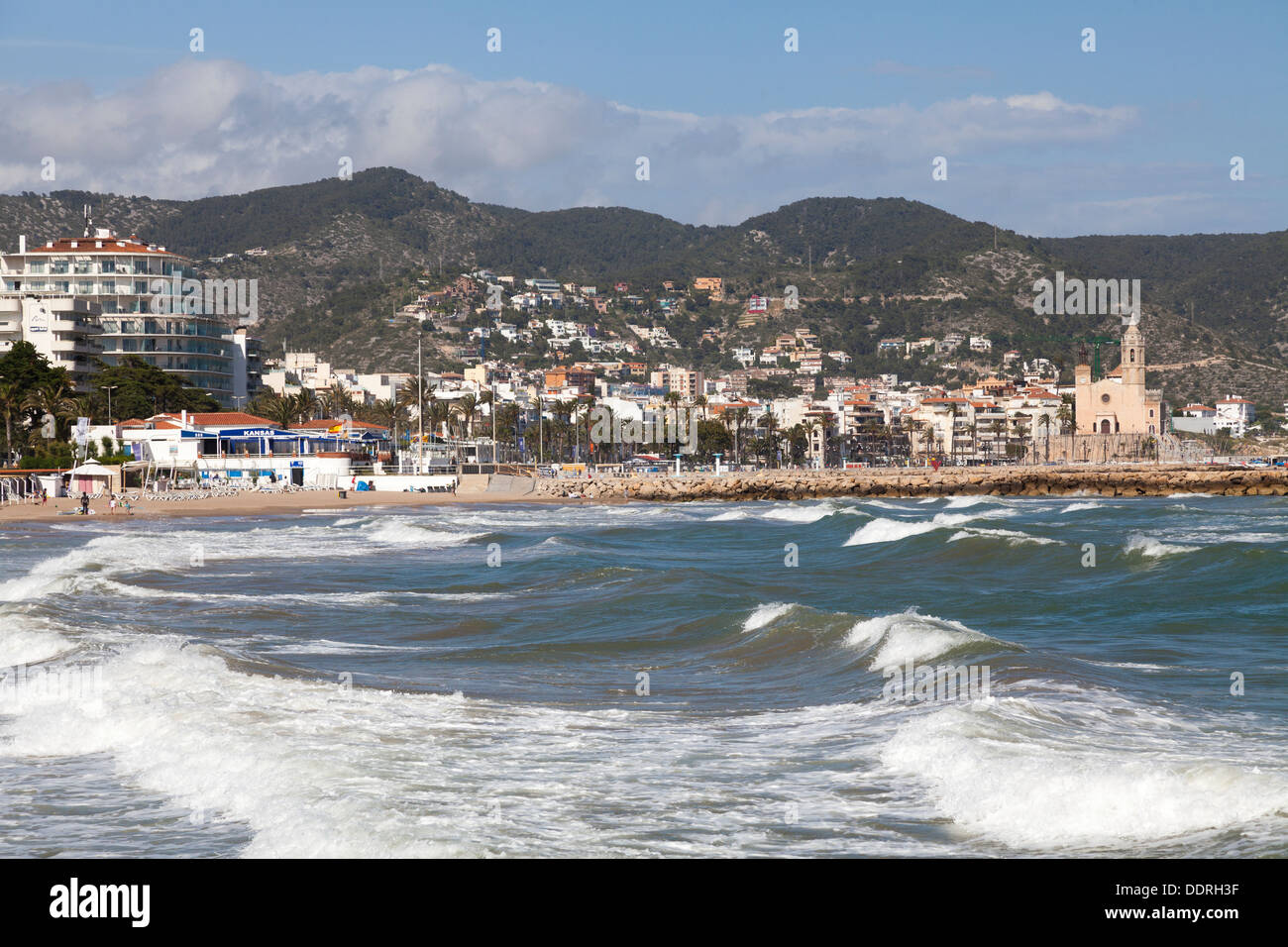 waves breaking on the sea front at Sitges - Stock Image
