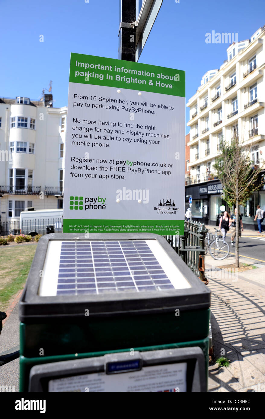 New Brighton and Hove City Council signs explaining how to buy car parking tickets using your mobile or smart phone app on solar powered meter - Stock Image