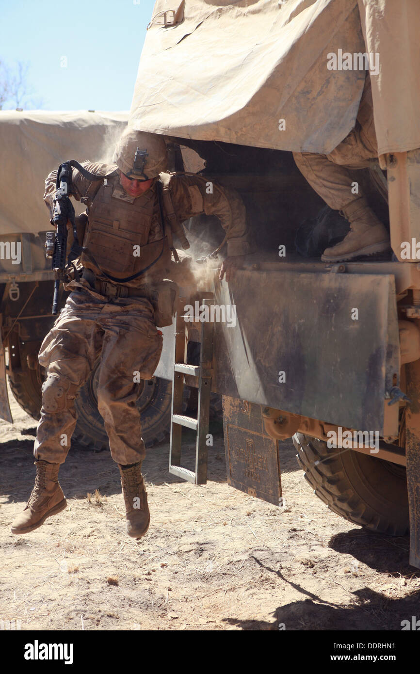 A Marine with Lima Company, 3rd Battalion, 3rd Marine Regiment, Marine Rotational Force - Darwin, jumps out the Stock Photo