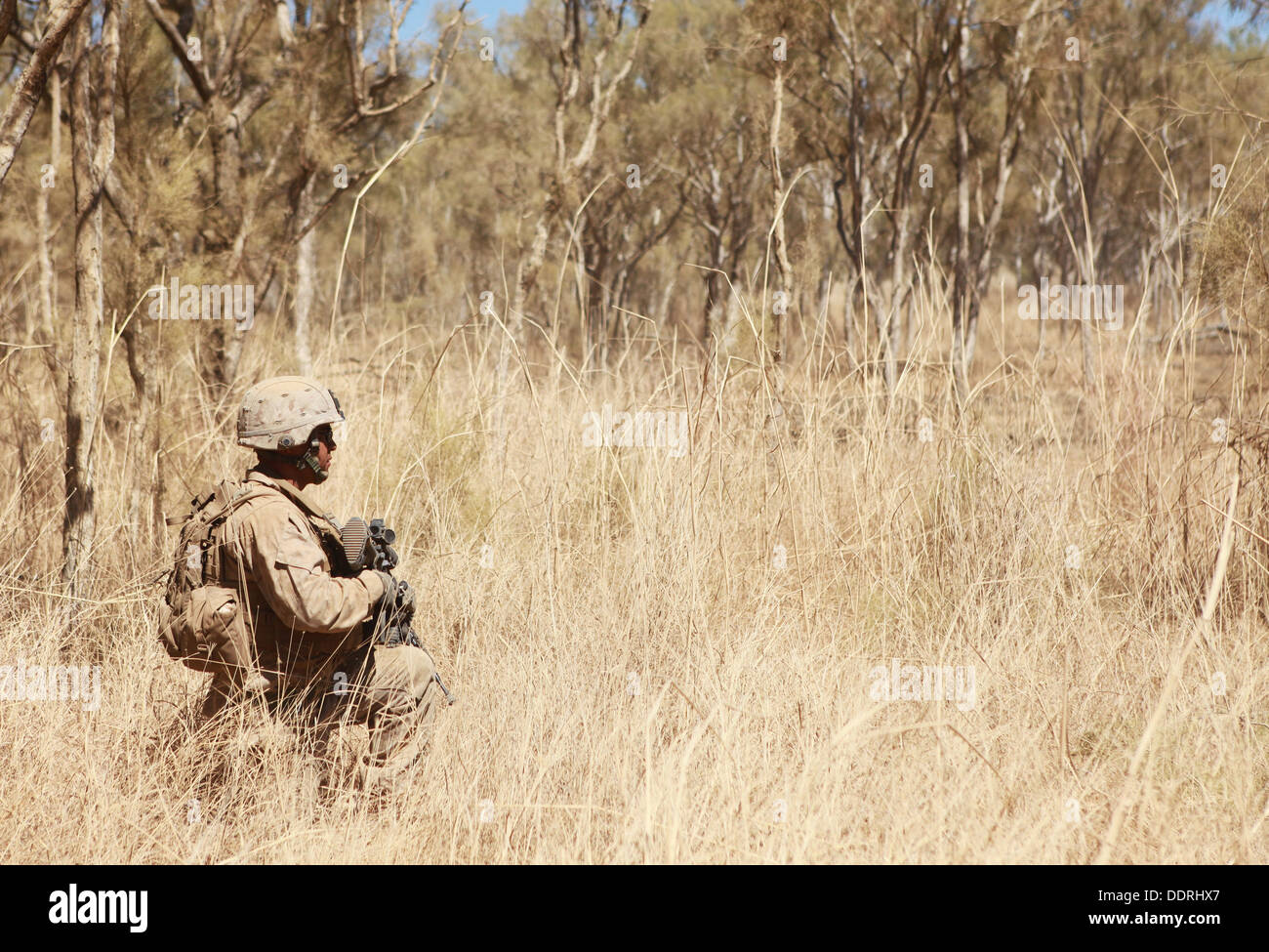 A Marine with Lima Company, 3rd Battalion, 3rd Marine Regiment, Marine Rotational Force - Darwin, waits to begin Stock Photo