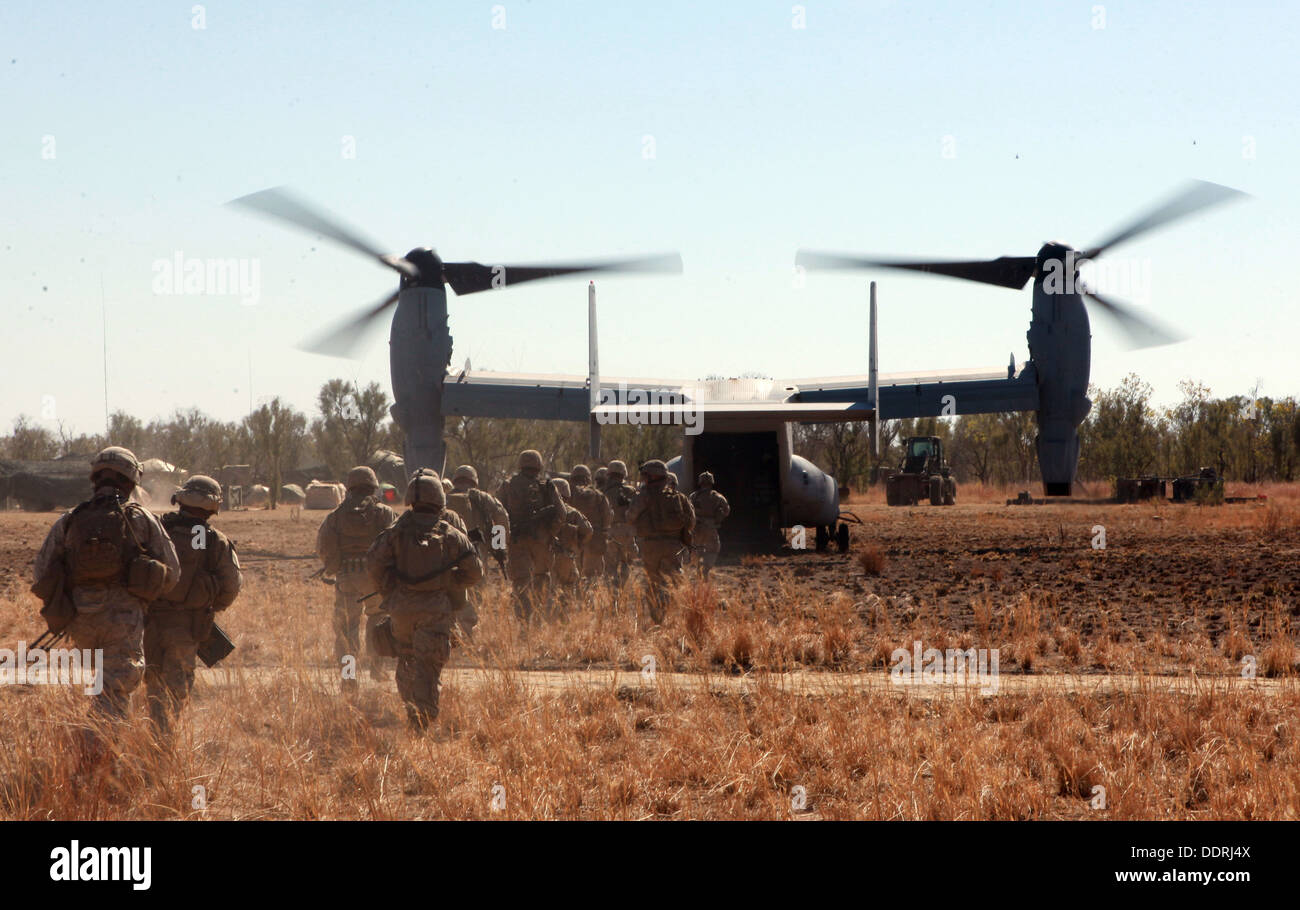 Marines with Lima Company, 3rd Battalion, 3rd Marine Regiment, Marine Rotational Force - Darwin, load into an MV Stock Photo