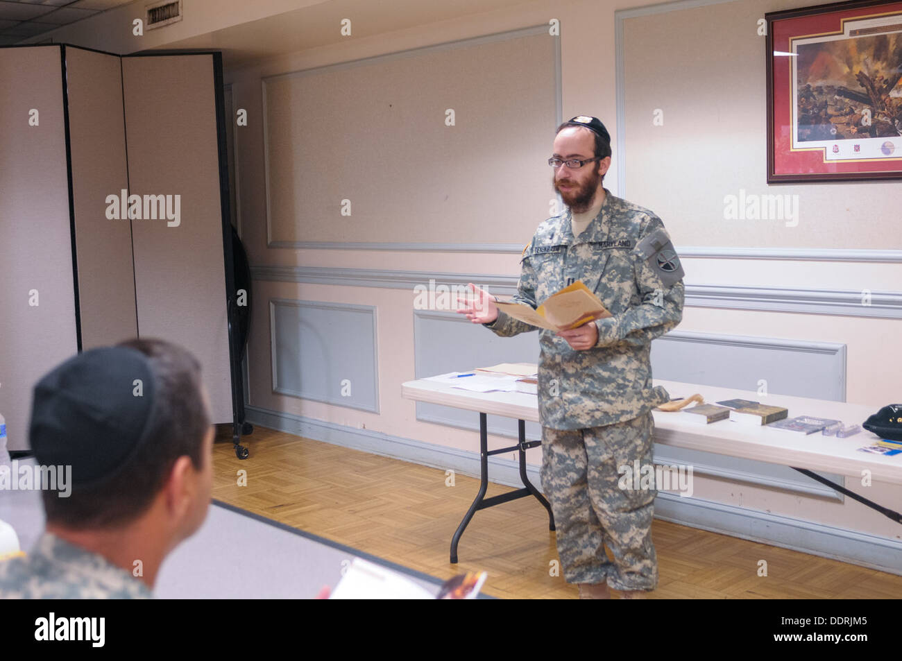 Soldiers present for the pre-Rosh Hashanah service learned more about Jewish customs, prayers, and religious symbols. Maryland Defense Force Chaplain (Capt.) Chesky Tenenbaum, the first bearded defense force chaplain of any state, held a pre-Rosh Hashanah - Stock Image