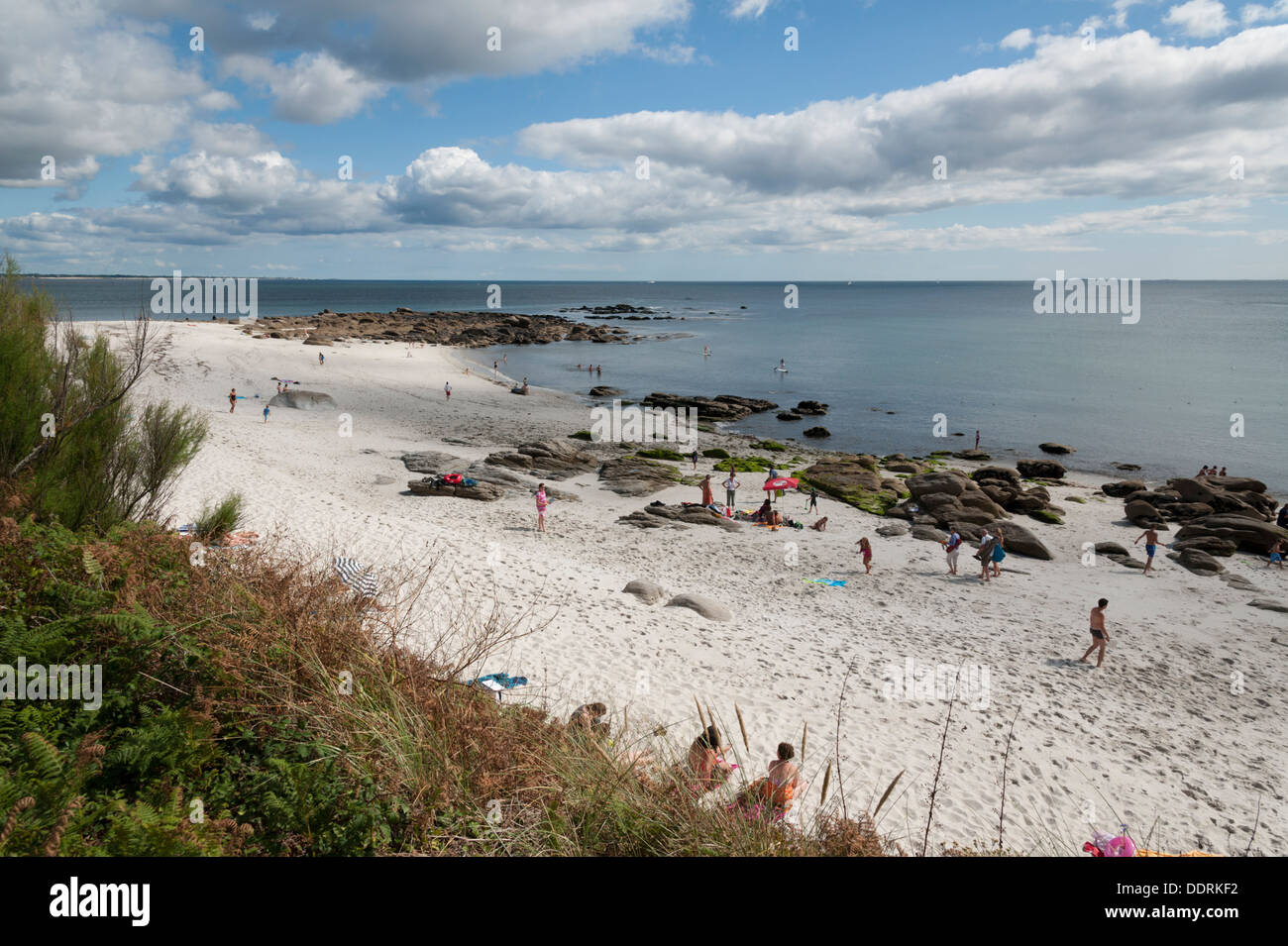 The beach with people relaxing at Beg Meil Brittany France - Stock Image