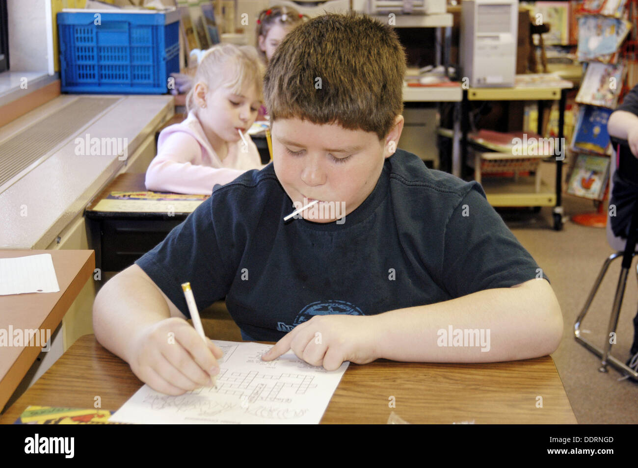 3rd students work on an individual basis. Stock Photo