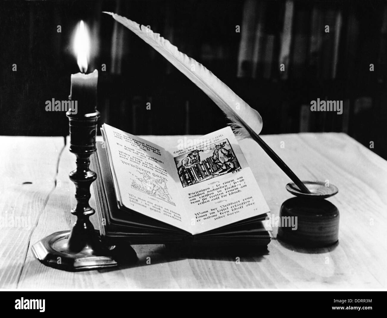 literature book still life of candle book and quill 20th century 20th century nostalgia candlestick candlesticks - Stock Image